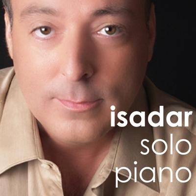 """This music video series was created specifically for cable-casting on Public Access television in New York City.  These 30-minute episodes contain Isadar's early 80's MTV inspired music videos along with episodes showcasing his Windham Hill inspired solo piano performances.  Eventually, all 12 episodes aired in Los Angeles and other large markets throughout the United States.  Episode One contains Isadar's cover of Kate Bush's """"Running Up That Hill (A Deal With God)"""" and Episode Three contains his cover of Madonna's """"Burning Up"""" whereas Episode Six contains his cover of her hit, """"Get Together.""""  In Solo Piano (Episode One), there is his cover of Windham Hill pianist Liz Story's """"Things With Wings,"""" and in Solo Piano (Episode Two) his cover of her composition, """"Wedding Rain."""" – Mainya Music Entertainment"""
