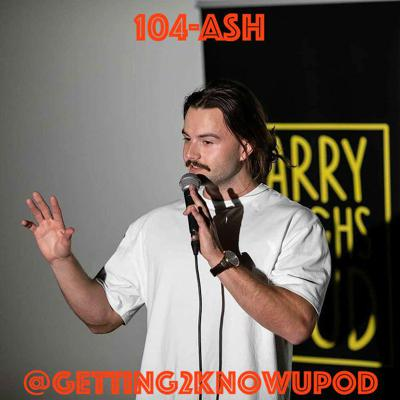 Cover art for 104-Ash: Comedian, Too Real for Corporate Employment, Thinks Ur Phone's Mic and Camera are Alway On, Enjoys Spreading Misinformation b/c it's Funny