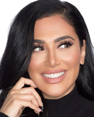 Cover art for Listen to Huda Kattan, CEO of Huda Beauty, talk about pursuing passion and purpose in your career.